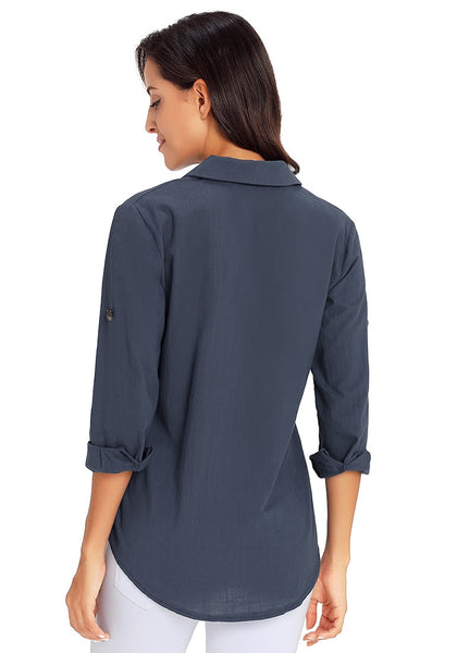 Back view of model wearing navy blue long cuffed sleeves lapel button-up blouse