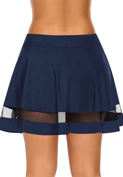 Back view of model wearing navy blue mesh panel flared swim skirt