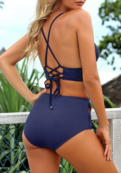 Back view of model wearing navy crisscross-waist cutout ruched bikini bottom