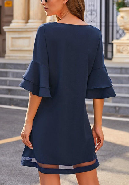Back view of model wearing  navy flare sleeves mesh panel V-neckline shift dress