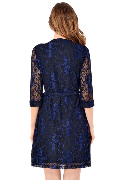 Back view of model wearing navy floral lace V neckline true wrap dress