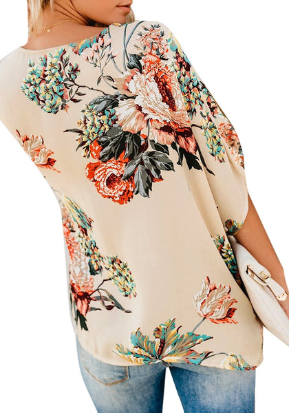 Back view of model wearing navy floral print V-neckline twist-front top