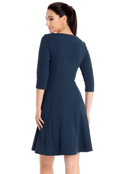 Back view of model wearing navy geometric textured casual skater dress