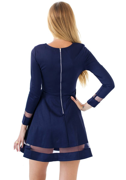 Back view of model wearing navy mesh panel skater dress