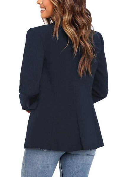 Back view of model wearing navy notch lapel double-breasted blazer