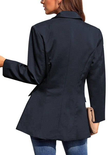 Back view of model wearing navy notch lapel double-breasted side pockets blazer