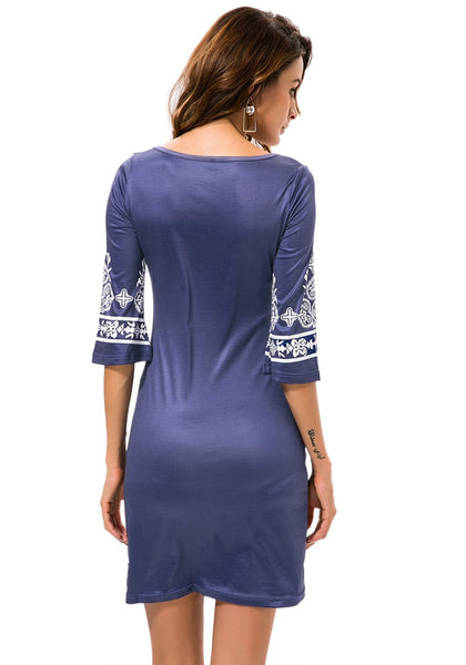 Back view of model wearing navy paisley print dress