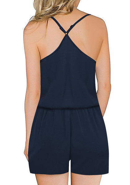 Back view of model wearing navy racerback spaghetti strap button-up romper