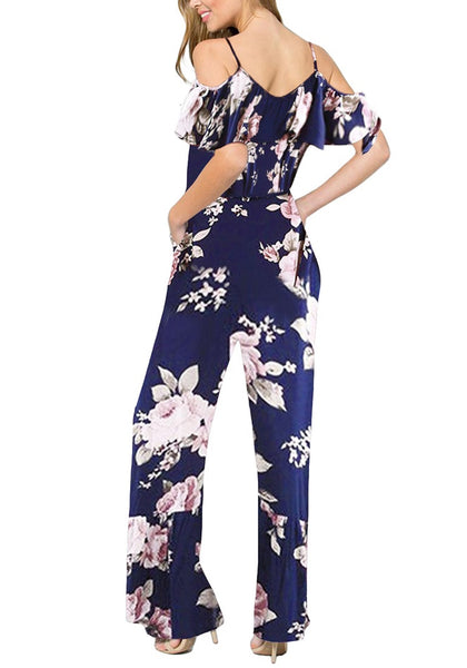 Back view of model wearing navy ruffled cold-shoulder wide-leg floral jumpsuit