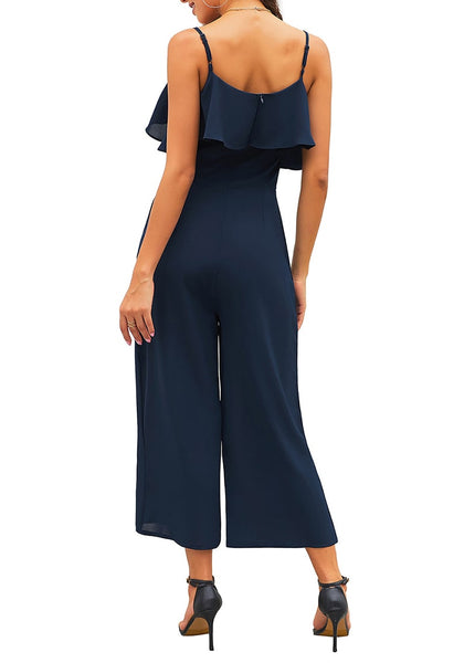 Back view of model wearing navy ruffled spaghetti-strap surplice jumpsuit's