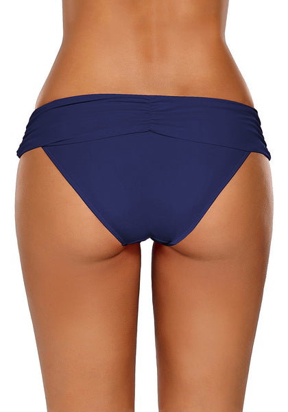 Back view of model wearing navy shirred waistband swim bottom