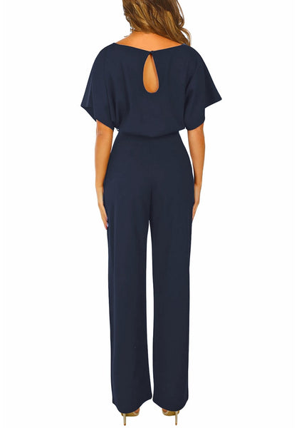 Back view of model wearing navy short sleeves keyhole-back belted jumpsuit