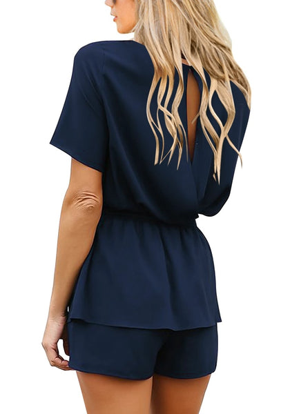 Back view of model wearing navy short sleeves keyhole-back belted romper