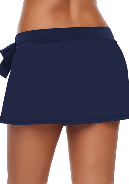 Back view of model wearing navy side slit bowknot swim skirt