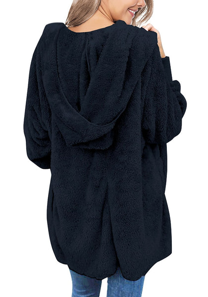 Back view of model wearing navy snuggle fleece oversized hooded cardigan