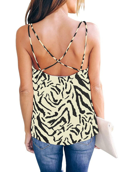 Back view of model wearing off white zebra-print strappy back loose cami top