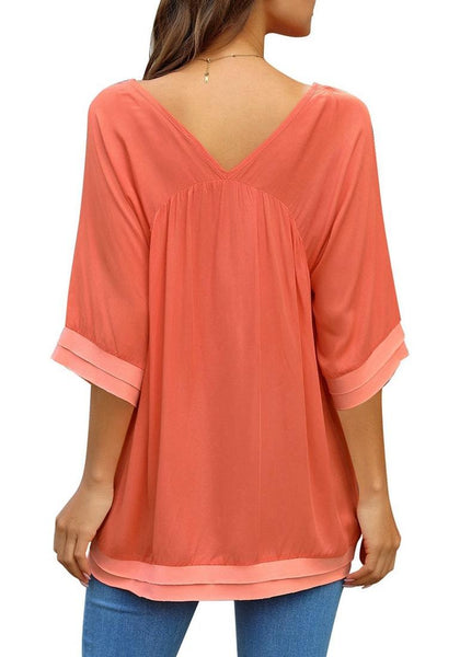 Back view of model wearing orange V-neck bell sleeves layered loose tunic top