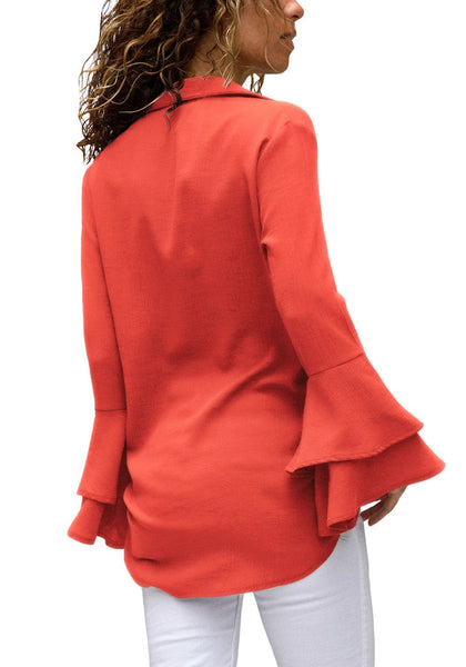 Back view of model wearing orange trumpet sleeves curved hem button-up top