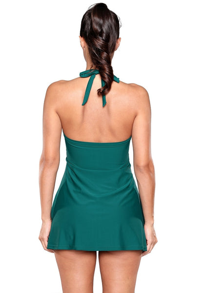 Back view of model wearing pine green striped halter swim dress