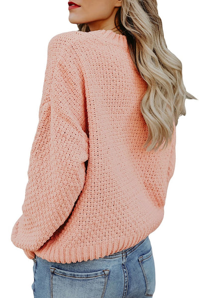 Back view of model wearing pink crew neck velvet cable knit pullover sweater