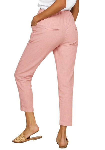 Back view of model wearing pink drawstring-waist rolled-up cropped pants