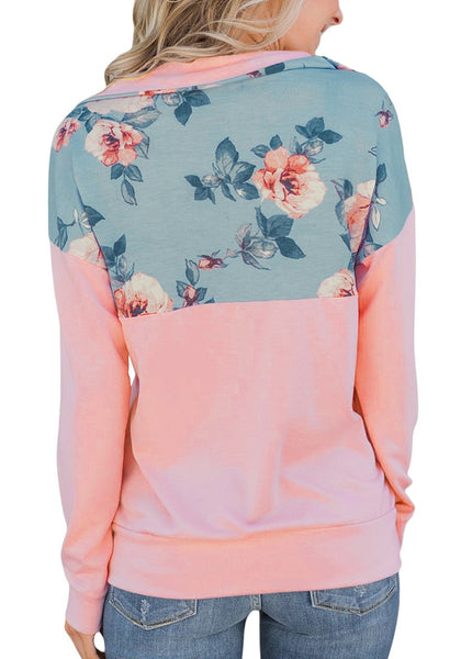 Back view of model wearing pink floral patchwork print half-zip pullover top