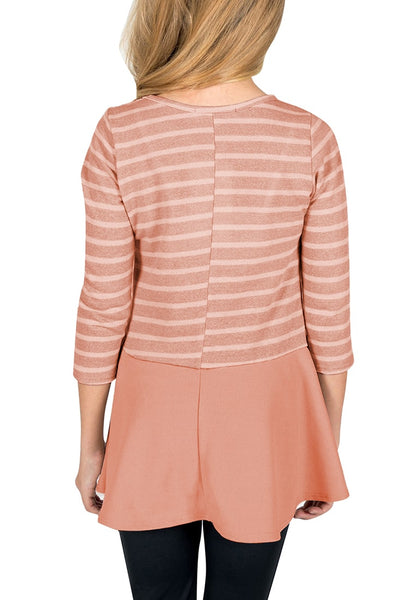 Back view of model wearing pink striped ruffle hem flared girl tunic top