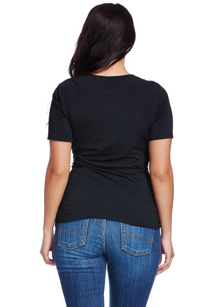 Back view of model wearing plus size black ruched surplice top
