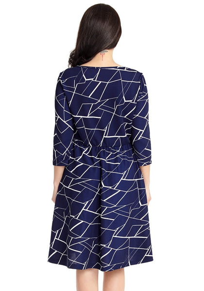 Back view of model wearing plus size navy geometric-print crop sleeves faux wrap dress