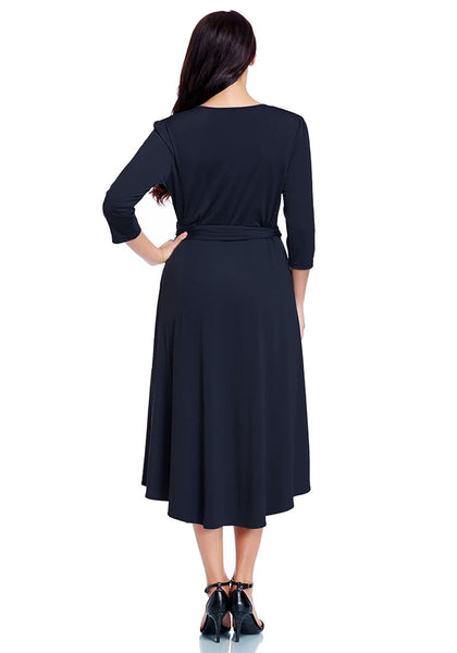 Back view of model wearing plus size navy high-low wrap skater dress