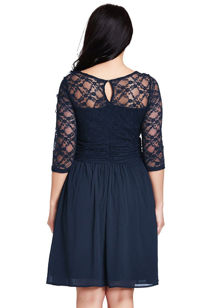 Back view of model wearing plus size navy lace crop-sleeves skater dress