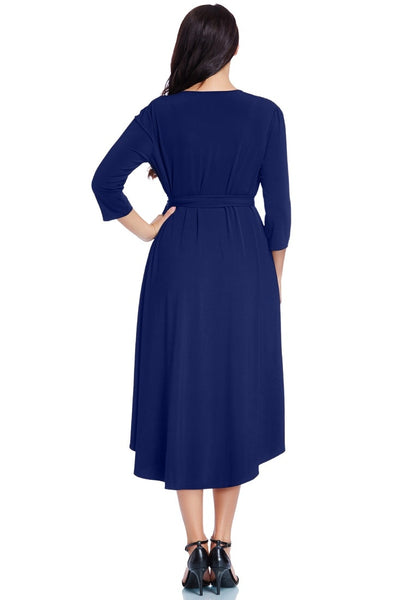 Back view of model wearing plus size royal blue high-low wrap skater dress