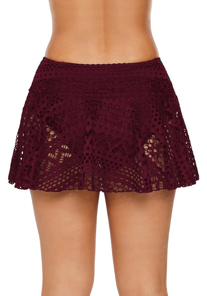 Back view of model wearing port lace crochet swim skirt