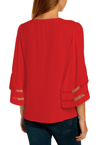 Back view of model wearing red 3/4 bell mesh panel sleeves V-neckline loose top