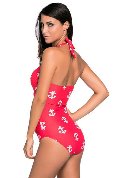 Back view of model wearing red anchors halter one-piece swimsuit