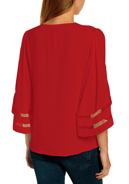 Back view of model wearing red mesh panel sleeves V-neckline Christmas-print loose top
