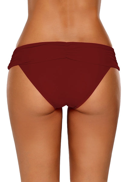 Back view of model wearing red shirred waistband swim bottom