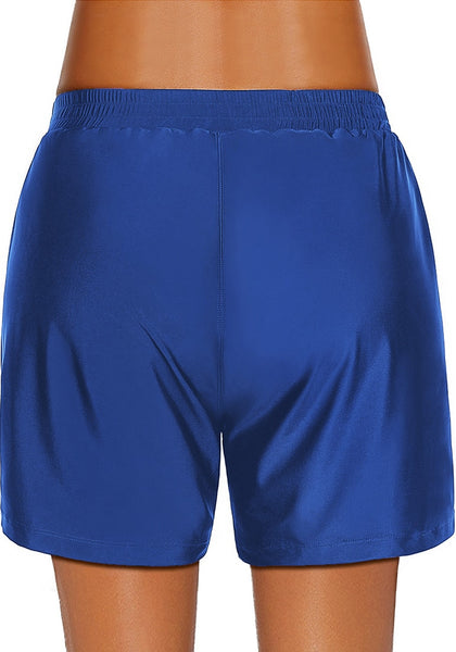 Back view of model wearing royal blue lace-up board shorts