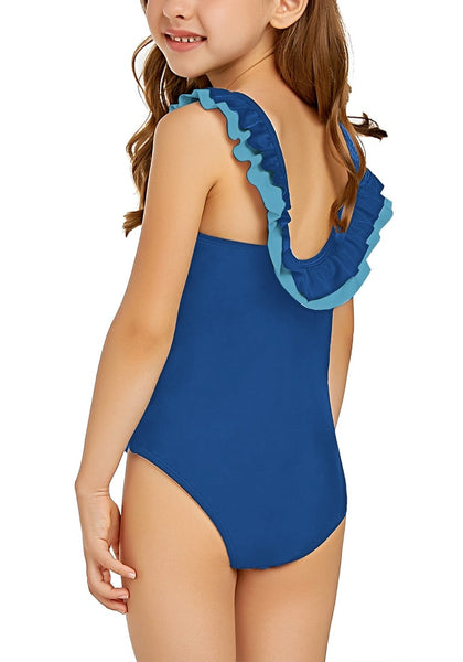 Back view of model wearing royal blue layered ruffle neckline one-piece girl swimsuit