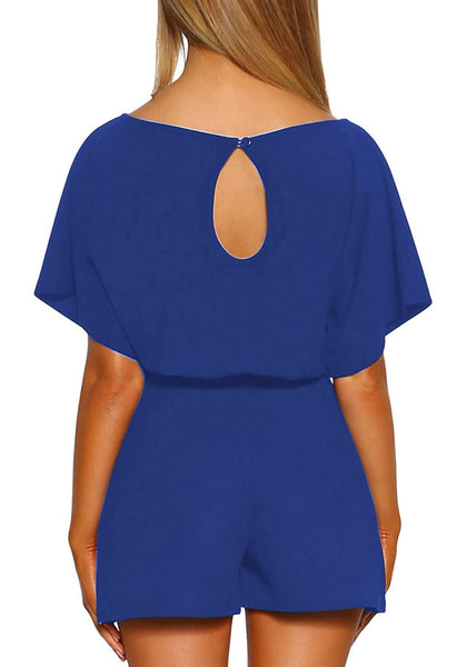 Back view of model wearing royal blue short sleeves keyhole-back belted romper
