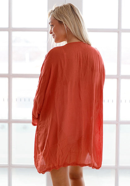 Back view of model wearing rust red embroidered beach kimono