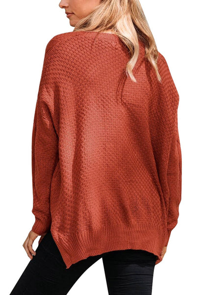 Back view of model wearing rust red ribbed knit textured side-slit sweater