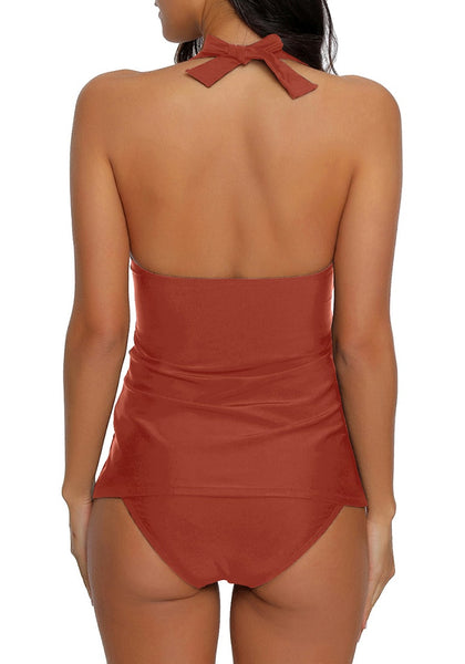 Back view of model wearing rust red solid color halter tankini set