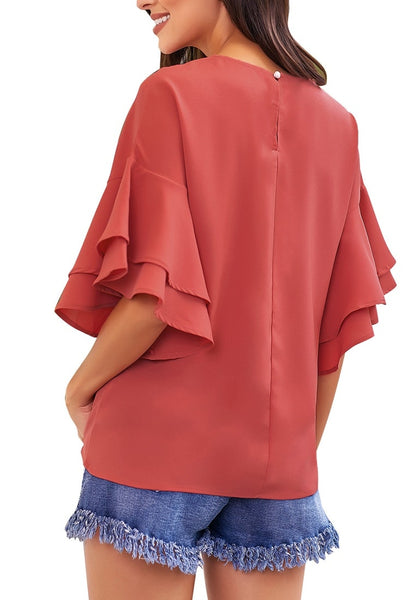 Back view of model wearing rust red trumpet sleeves keyhole-back blouse