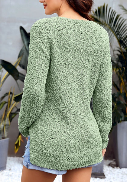Back view of model wearing sage green V-neckline popcorn fuzzy fleece pullover sweater