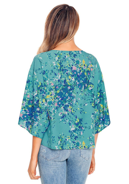 Back view of model wearing sky blue floral print tie front chiffon blouse
