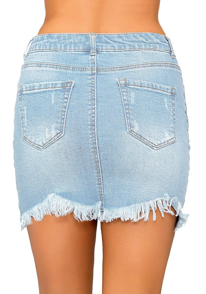 Back view of model wearing sky blue frayed hem washed denim mini skirt
