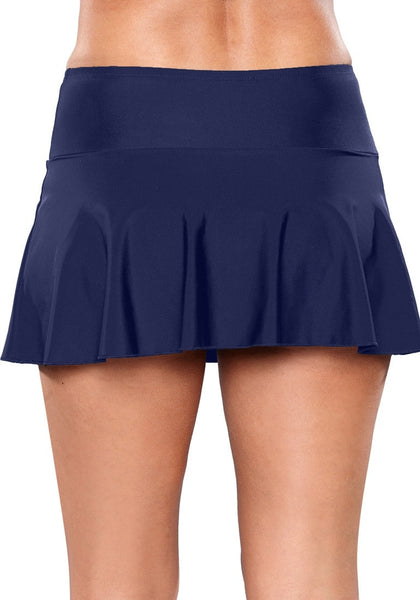 Back view of model wearing solid navy flared swim skirt