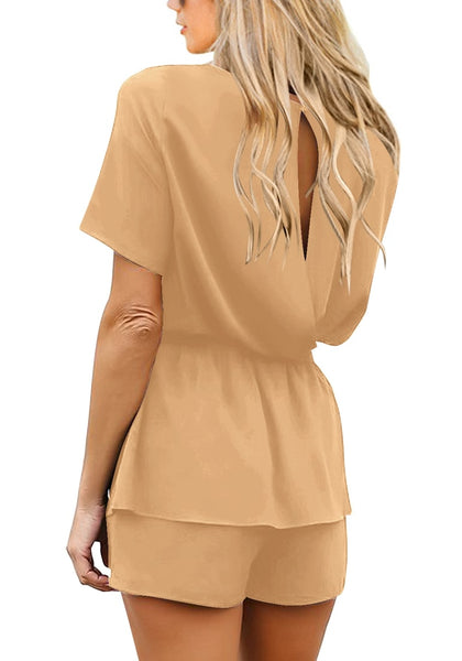 Back view of model wearing tan short sleeves keyhole-back belted romper