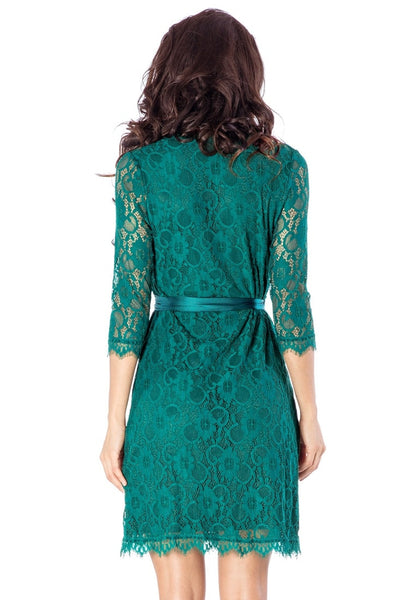 Back view of model wearing teal lace overlay plunge wrap-style dress